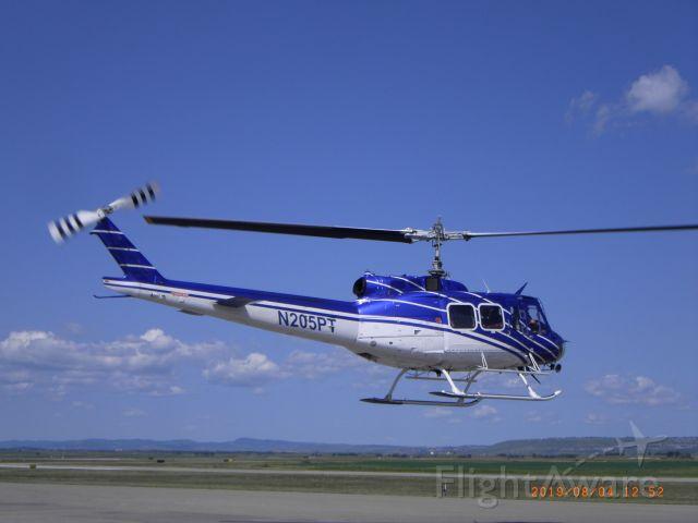 Cessna Skylane (N205PT) - N205PT Bell 205A-1 Helicopter