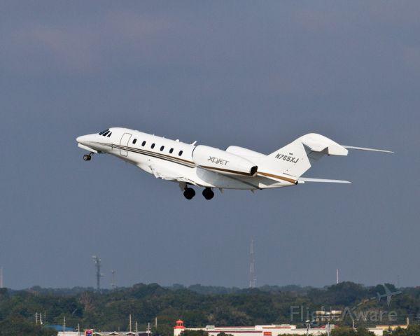 Cessna Citation X (N765XJ) - A beautiful XOJET Citation X departing Orlando.