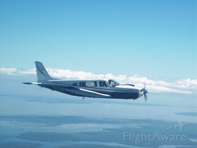 Piper Saratoga/Lance (N8147B) - Air to Air formation shot from a Mooney on the way down to W95 (Okracoke)