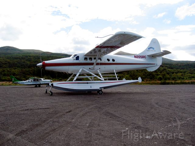 De Havilland Canada Twin Otter (N205RC) - Elegant Turbo Beaver belonging to Rapids Camp Lodge parked at the Larsen Bay, Alaska airport on August 31, 2005, with Servant Air Cessna 207 in the background.