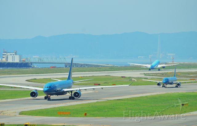 Airbus A330-200 (VNA375) - Three blue aircraft in regular traffic operations.  Airline: Vietnam Airlines (VN/HVN); Airport: Kansai International Airport (KIX/RJBB); Camera: Nikon D7000; Date: 4 July 2012