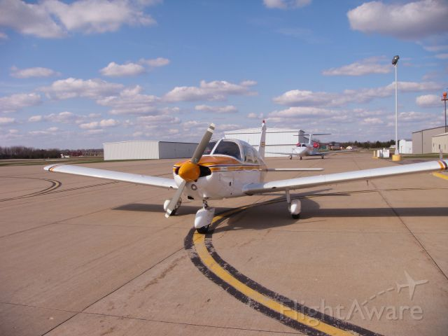 Piper Cherokee (N64MS) - Fueling at the FBO on a wonderful spring day.
