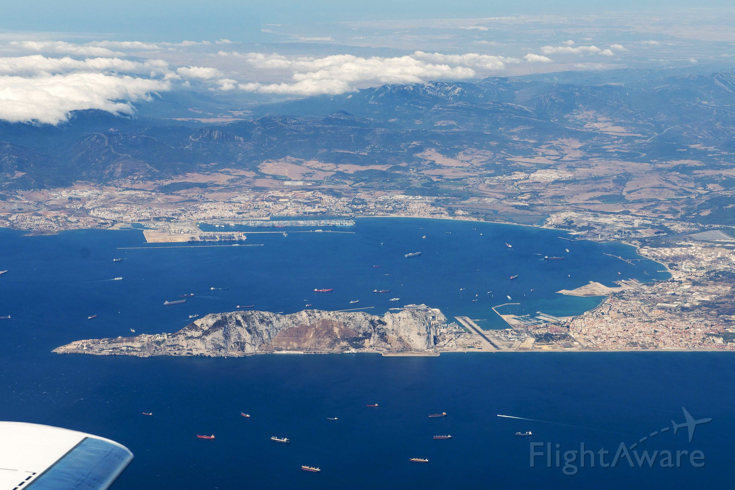 — — - Image taken after take-off from Gibraltar on Falcon 900EX - left turn out from Runway 27 shows great vista of Rock of Gibraltar, Gibraltar Airport with Algiceras Spain under the cloud. We were on route to EGHI.