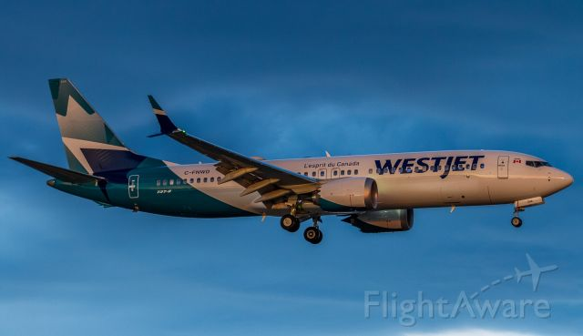 Boeing 737 MAX 8 (C-FNWD) - Westjet new livery just after sunset on short finals for runway 23