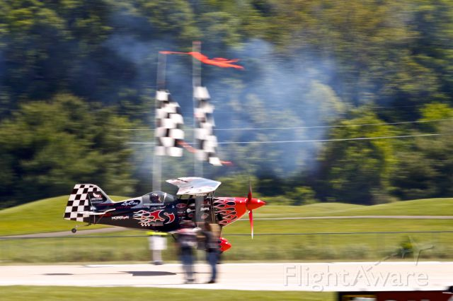 Experimental 100kts (N540SS) - Skip Stewart flying under the ribbons at the Spirit of St Louis Air Show