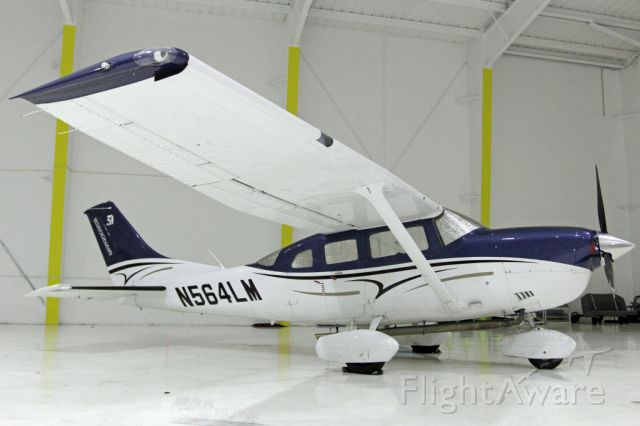 Cessna Centurion (N564LM) - The exhaust had me thinking ... the Canon cameras mounted under explained it - aerial mapping Cessna!