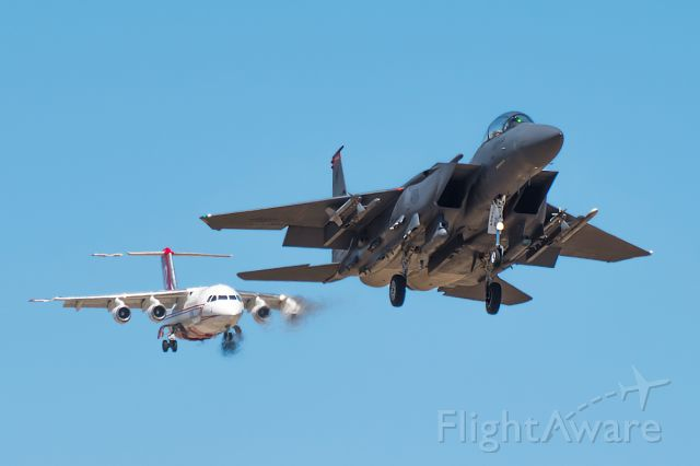 McDonnell Douglas F-15 Eagle (87-0402) - Dropper 22 cutting off the BaE146 Firebomber.  Just Kidding, he didnt.  The F15E was landing on the south runway and the BaE was landing on the north! It was a safe landing for everyone! Full Quality photo: a rel=nofollow href=http://jetphotos.net/viewphoto.php?id=8093460http://jetphotos.net/viewphoto.php?id=8093460/a If you like to see more of my stuff follow me on Instagram! boispotter