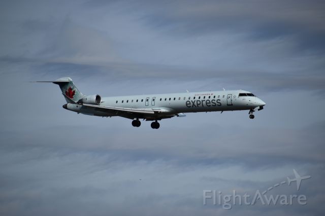 Canadair Regional Jet CRJ-900 (C-FUJZ) - Taken at the Founders Plaza, while watching planes land onto runway 18R