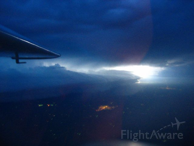 Cessna Cardinal (N7577V) - Lightning storm lighting up the clouds on the plains of Nebraska.  Dad and I on the way back from Denver.