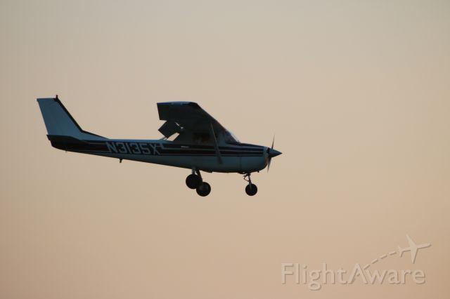 Cessna Commuter (N3135X) - N3135X landing RW 35 @ KSEG on a summer night.
