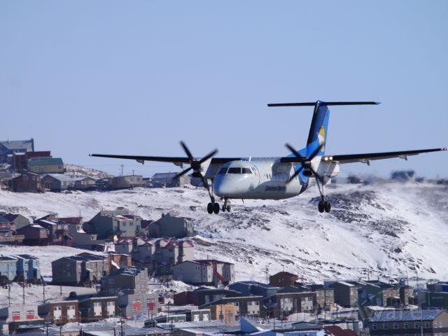 de Havilland Dash 8-100 (C-GXCN) - Canadian North Dash 8, arriving at Iqaluit airport.