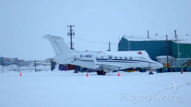 Embraer Phenom 300 (LNX23JG) - Snowing in Iqaluit, Nunavut