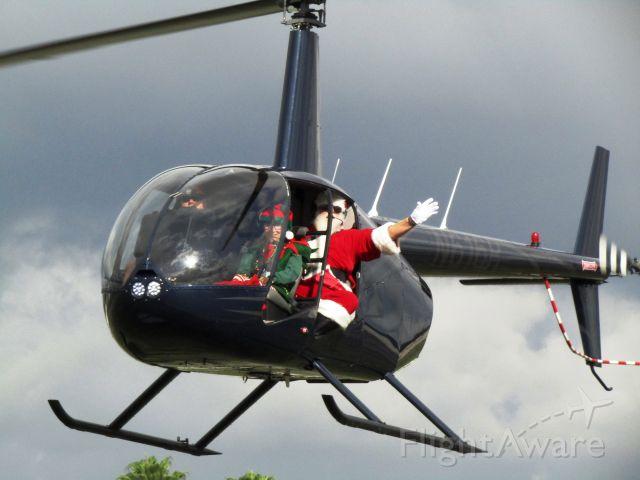Robinson R-44 (N616R) - Santa and elf landing at KFUL