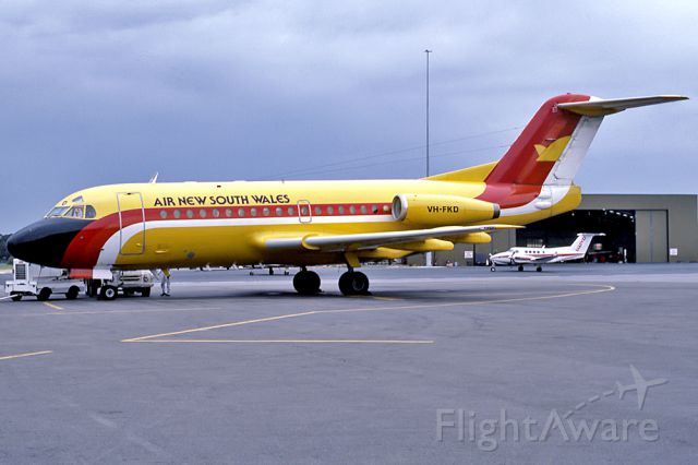 — — - AIR NEW SOUTH WALES - FOKKER F-28-1000 FELLOWSHIP - REG : VH-FKD (CN 11026) - KINGSFORD SMITH SYDNEY NSW. AUSTRALIA - YSSY 12/6/1985 35 MM SLIDE CONVERSION USING A LIGHTBOX AND A NIKON L810 DIGITAL CAMERA IN THE MACRO MODE.