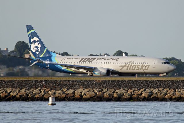Boeing 737-900 (N248AK) - Wearing new titles Boeing 100 years strong