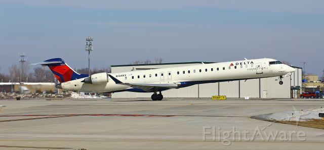 Canadair Regional Jet CRJ-900 (N134EV) - Taking off on runway 14