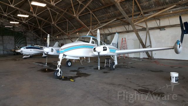 Cessna 310 (N6709X) - It just got washed and pushed back in the hangar.