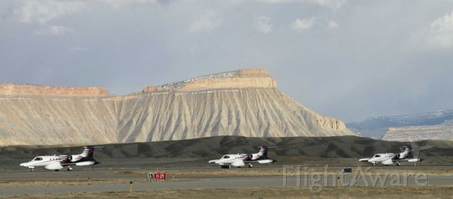 Learjet 35 (N136DH) - One of my better stitches, against the backdrop of Mt Garfield - MRK at the helm.