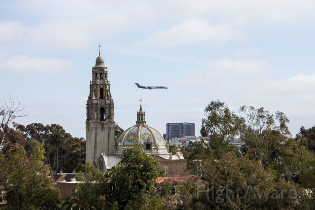McDonnell Douglas MD-80 — - MD-80 on final to the San Diego airport. This was taken from the skyfari overhead tram at the San Diego Zoo.