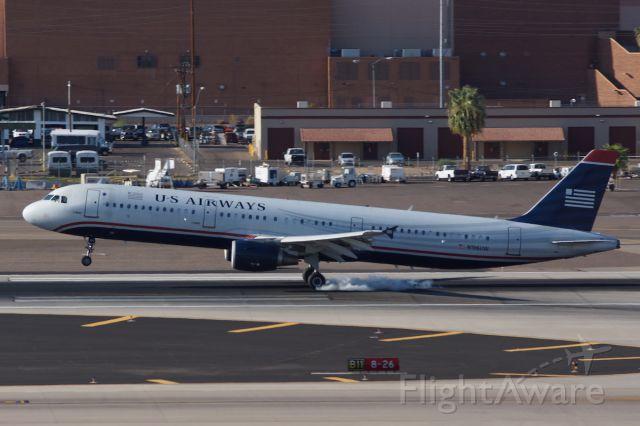 — — - US Airways smoking tires at KPHX