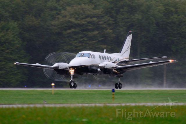 Beechcraft Super King Air 200 — - Departing runway 8 during a soaking rain shower