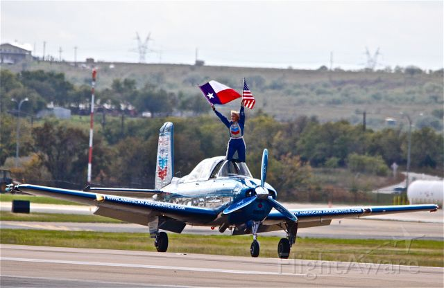 Beechcraft Mentor (N134JC) - ALLIANC,FORT WORTH AIR SHOW,2009,  JULIE CLARK IN HER T-34 MENTOR SALUTES THE CROWD AND ANOTHER SUCCESSFUL SHOW