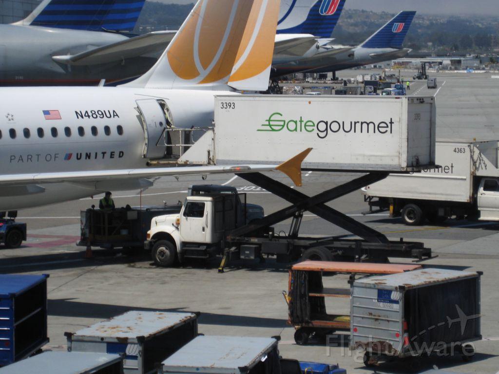 Airbus A320 (N489UA) - TED A320 gets food? KSFO