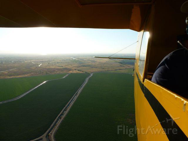 "Piper Cherokee (N22957) - ""Open cockpit"" in a Piper Cub"