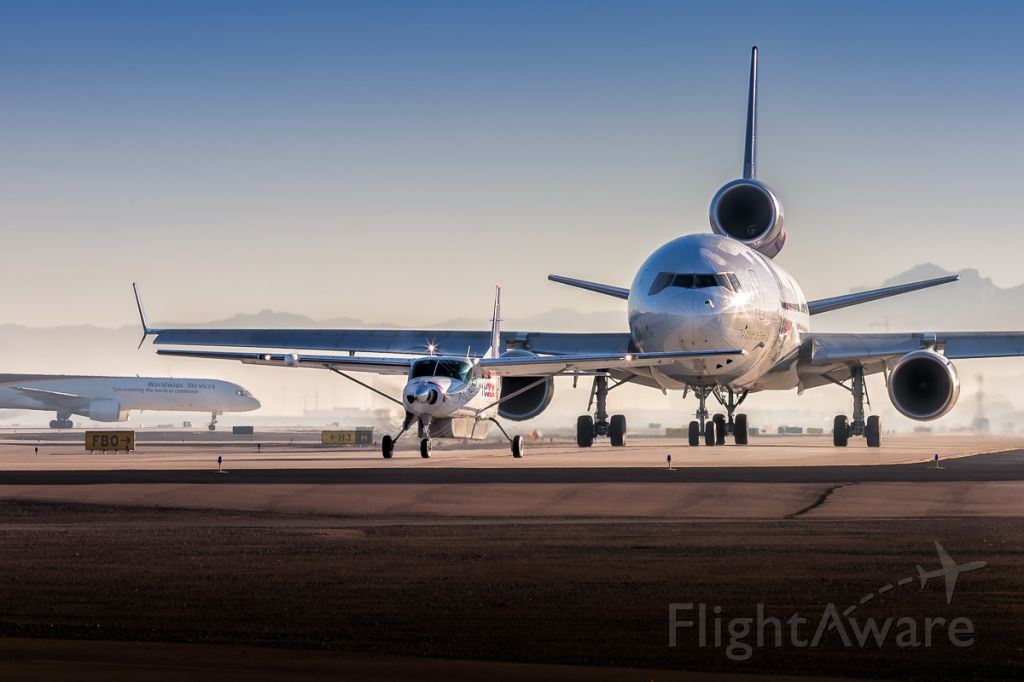 Boeing MD-11 — - Early morning holiday cargo traffic at KPHX.