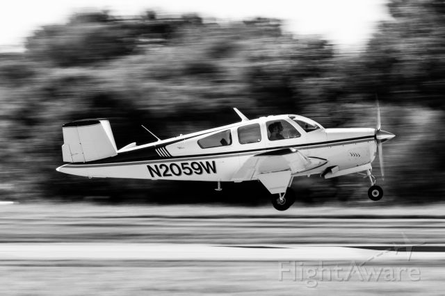 N2059W — - V tail Bonanza taking off from Clermont County. Lighting was backlit so I figured I'd try a fun edit