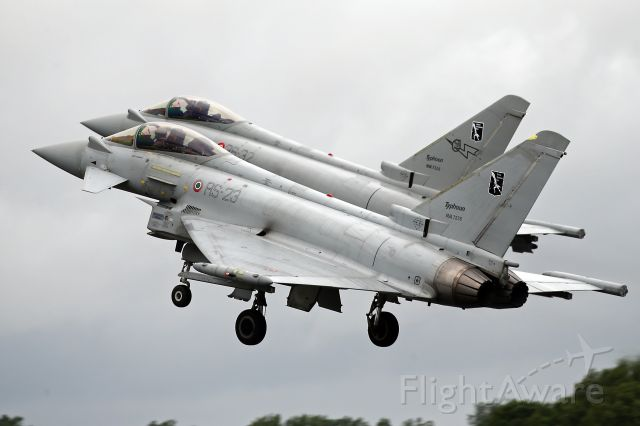 — — - Paired take-off of Italian AF experimental squadron Typhoon off the deck at RAF Fairford, UK.