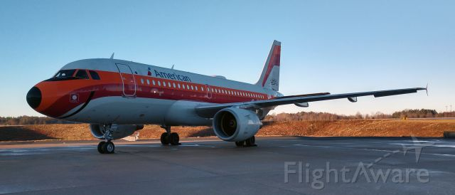 Airbus A319 (N742PS) - PSA retro sitting at the hanger after an overnight stay.<br /><br />12/16/18