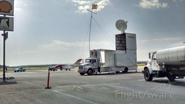 N420HM — - Preparing for flight test, telemetry truck to log data.