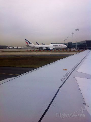 Boeing 747-200 — - Taxi past an Air France 747-400 at DeGaulle in Paris.  Nasty airport.