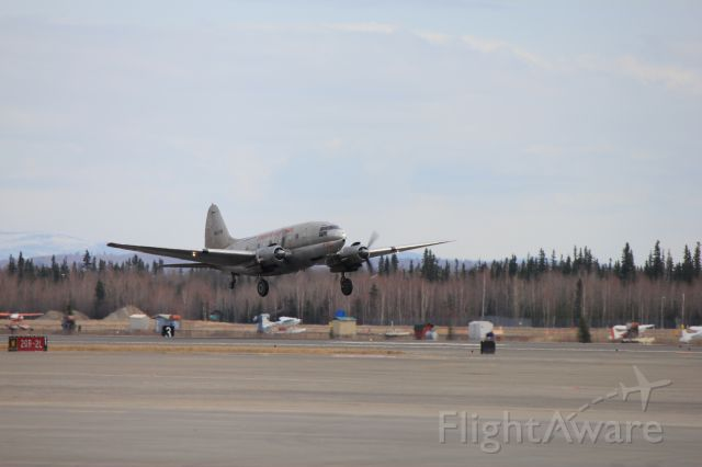 CURTISS Commando — - C-46 Hot Stuff taking off with another load of fuel for one of the villages in the interior of Alaska.