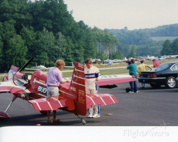 STEPHENS Akro (N10LL) - SUSSEX AIRPORT, SUSSEX, NEW JERSEY, USA-AUGUST 1993: Pictured on the right, in his white flight suit, performing some last minute checks on his AKRO Laser 200 aircraft is former U.S. National and World Aerobatic Champion pilot Leo Loudenslager. This picture was taken during the 1993 Sussex Airshow.