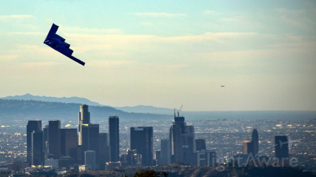 Northrop Spirit (82-1066) - B-2 Spirit of America flys past Downtown Los Angeles before flying over for the Rose Parade on a clear New Years Day