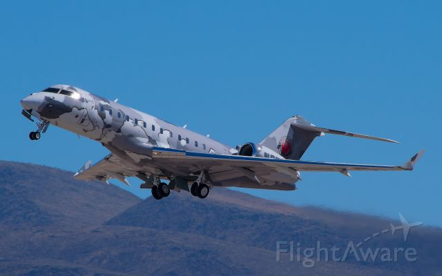 Bombardier Global Express (N2T) - This is the only departure photo of N2T I got with the mountains included.