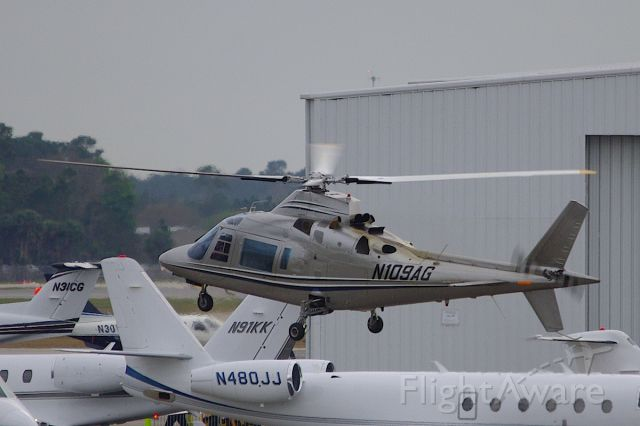 SABCA A-109 (N109AG) - Landing on the Sheltair Ramp, on another heli-shuttle run from KXFL for the Daytona 500.