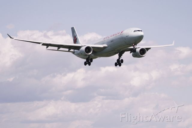 Airbus A330-300 (C-GHKW) - 2010:08:17. 15:53 A330 on final Runway 25 in gusty headwind