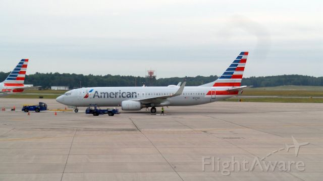 Boeing 737-800 (N921AN) - American N921AN being backed away from terminal at KBDL, early AM.