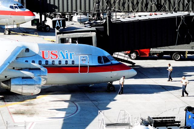 "British Aerospace BAe-146-200 (N183US) - KSJC - early 1990s at Gate A1 - note the ""mature"" ramp crew............."