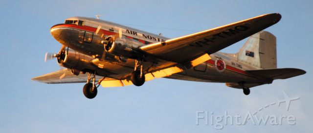 Douglas DC-3 (VH-TMQ) - on approach to Essendon airport at sunset, May 2018