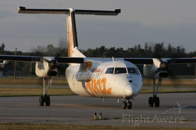de Havilland Dash 8-300 (C-GSTA) - July 19, 2007 - arrived London