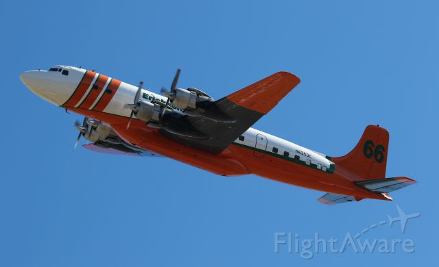 Douglas DC-7 (N6353C) - Departing the Rogue Valley International–Medford Airport for Chico, CA.