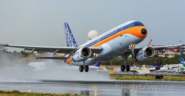 Airbus A320 (N763JB) - JetBlue departing in the rain at TNCM St Maarten.