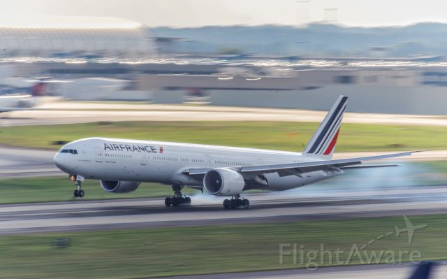 BOEING 777-300ER (F-GZNR) - AF681 setting the mains down on 8L after a flight across the pond from Paris