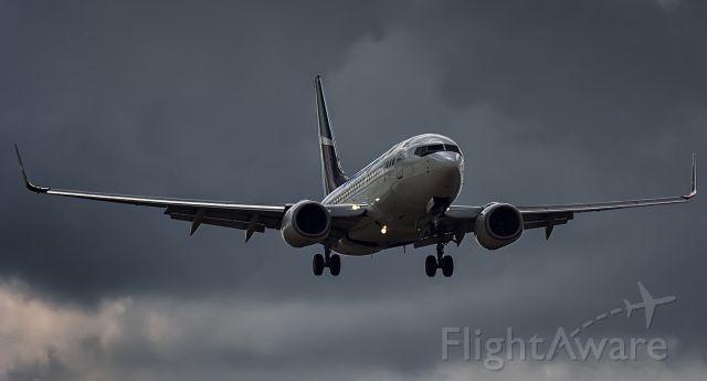 Boeing 737-700 (C-GTWS) - Taken from Creamery, runway 33