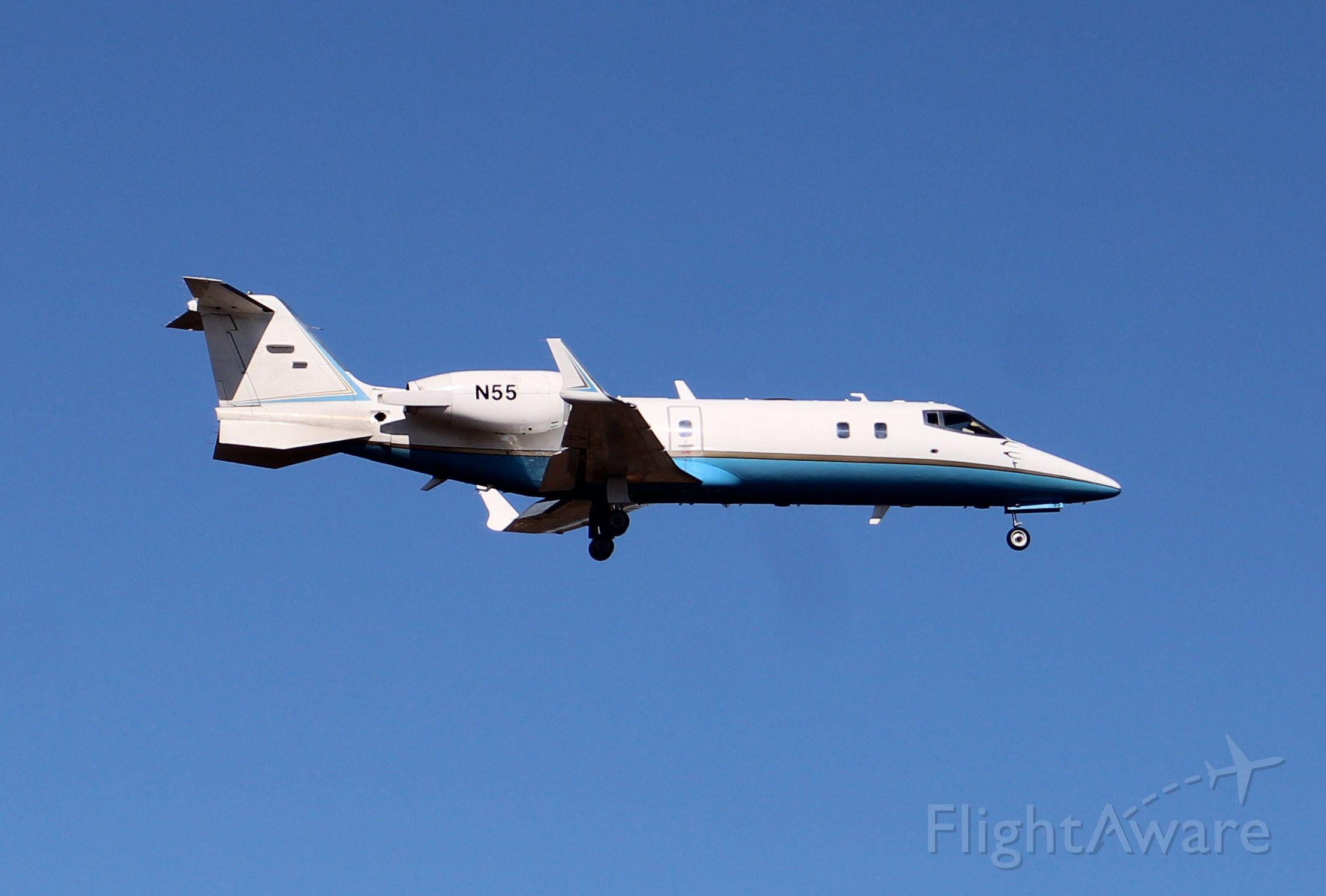 Learjet 60 (N55) - A Learjet 60 passing low and slow down the runway at Thomas J. Brumlik Field, Albertville Regional Airport, AL - February 15, 2017.