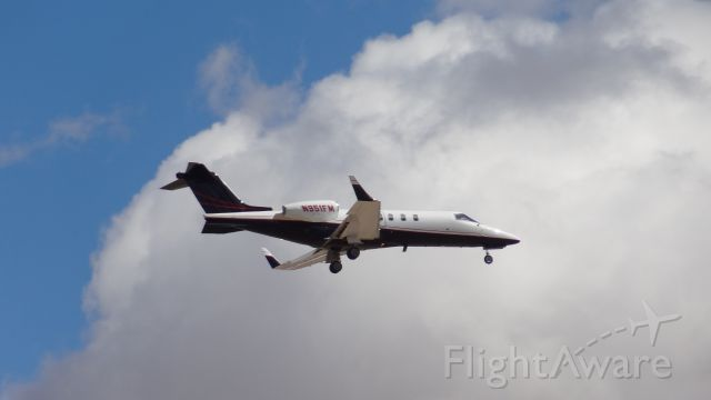 Learjet 40 (N951FM) - N951FM landing at runway 11 at Tucson International on March 2, 2014 at 12:15 in the afternoon.